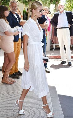 Hailey Baldwin from Cannes 2017: Street Style  This season's must-have: the shirt dress. Take note from Hailey's outfit and wear with ultra-feminine heels for a sultry twist.
