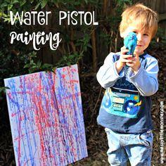 Water pistol (squirt gun) painting.  Outdoor kids art activity for Summer. Inspired by famous artist Jackson Polluck.