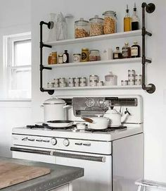 Industrial shelving and a vintage stove.