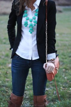 Black card, brown boots and teal bubble necklace.