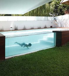 Designed by Andres Remy Architects, a modern above-ground outdoor pool in Devoto, Argentina     When planning the placement of the swimming pool, the architects carefully studied the path of the sun. The pool is elevated from the ground creating a glass wall that allows views from within and outside. Even people inside the house can see the action in the pool while lounging on the sofa.