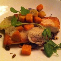 Pan fried #snakehead fish at @RippleWDC - served with sweet potatoes, wild rice and caper emulsion.