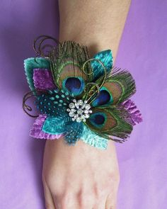 Peacock Wedding Wrist Corsage. $26.50, via Etsy.  would be cute for my mom :)