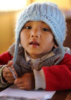 Laos, boy in primary school