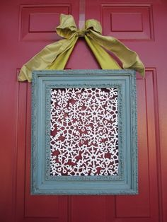 Update the traditional wreath by using a square frame. Fill it with your favorite scrapbook paper or a paper cut-out. Put initial in middle
