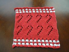 This hand knit red and white Candy Canes on Parade cloth will be a special addition to any home for the holidays. The unique design of 6