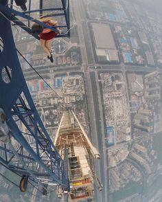 Photographer Angela Nikolau has taken selfies to sky-high levels with her thrilling and dangerous shots across some of the world's riskiest urban locations - vertigo