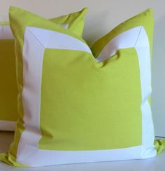 Set of Two - Citron pillows - 20, 22 or 24 inch - Decorative Pillow - white ribbon embellishment - neon bright - made to order. $85.00, via Etsy.