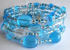 Cool Pure Aqua Blue Transparent and Silver Oval Memory Wire Bracelet by VineDesignBeads. Visit me on Etsy!