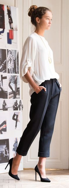 Minimal + Chic | navy cropped trousers with cream blouse and long pendant necklace, heels to wear to work, office style