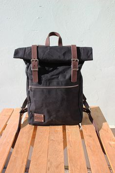 Size when rolled: 43x30x12 cm. (17*12*4.7 inches) Big front zipper pocket. Two pockets inside. Color: Black  You can choose between brown, black and
