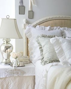 Ruffled bedding and a mercury lamp make for a romantic bedroom