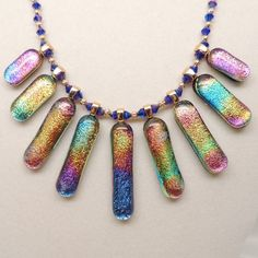 Dichroic Glass Fan Necklace Strung with Chinese crystal and gold plated rounds by DesignsbyAlladania. $205.00, via Etsy.