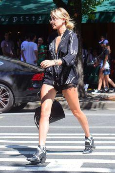 90 celebrity denim looks to copy: Hailey Baldwin struts the streets of LA wearing a dark wash jean romper