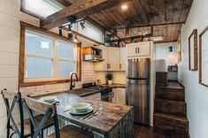 27 Clever Tiny House Kitchen Ideas (Photos) Stunning rustic tiny house kitchen with dark wood countertops, dark wood ceiling, white subway tile and stainless steel appliances. Tiny Home Cost, Small Tiny House, Tiny House Living, Tiny House Plans, Tiny House Design, Small Living, White Farmhouse Sink, House Staircase, Staircase Ideas