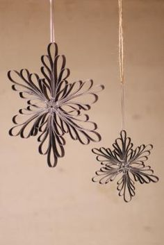 pretty black snowflakes - try making out of strips of paper