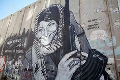 21673844-Leila-Khaled-graffiti-on-the-Israeli-West-Bank-barrier-near-Bethlehem-The-israeli-West-bank-barrier--Stock-Photo.jpg (1300×866)