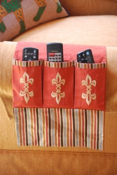 Nothing Says TV Room Organization like this 3 slot cloth Remote Control Holder- Perfectly designed to hold your remote controls in an organized yet stylish way. Each Slot is carefully embroidered with Unique design in Gold threads.