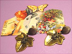 """Pierced vintage earrings.  Leaf is 7/8"""" long, has the appearance of brass and on each leaf is an adorable little 1/4"""" frog!  The ear piece looks like a shell.  Total measurement of earring is 1-3/8"""".  (Have one pair.  Price is $2.99.)"""