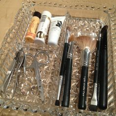 Place makeup/beauty tools in a pretty crystal dish. I purchased mine for $ 2.00 at Goodwill. (and washed it well, of course!)