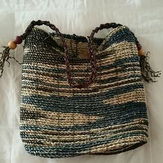 boho style tote Gently used boho style straw bag! Big button front closure large bead detail on sides! world market Bags Totes