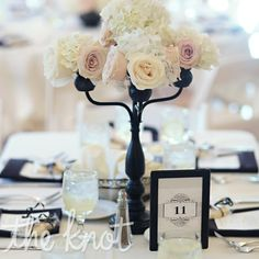 17-inch black candelabras... love this look with them dressed up by roses and hydrangeas