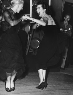 Ginger Rogers and Ann Miller perform the Charleston together at the Mocambo nightclub in West Hollywood, February 1950.