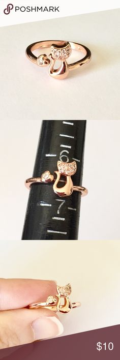 Rose Gold Cat & Heart Adjustable Ring Perfect for cat lovers. This adjustable rose gold colored ring features a kitty and a tiny heart with clear rhinestones. Adjustable from size 6.5 up. Brand new and never worn. Not intended for children under 12. Jewelry Rings