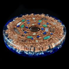 Hematite Orgonite style Charging Plate. Tibetan Crystals, Phenacite, Amazonite, Lapis Lazuli, Selenite, Rhodizite, SBB Coil & Copper (640). $75.00, via Etsy.