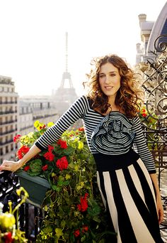 carrie bradshaw on her balcony, the first day in Paris