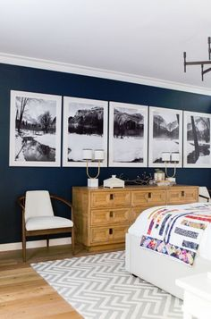 Line It Up: A Modern Tweak to the Ubiquitous Gallery Wall - Home & Living - Bedroom Decor Home Bedroom, Bedroom Decor, Artwork For Bedroom, Decorating A Bedroom, Bedroom Wall Pictures, A Frame Bedroom, Decorating A Large Wall In Living Room, Bedroom Prints, Bedroom Pictures