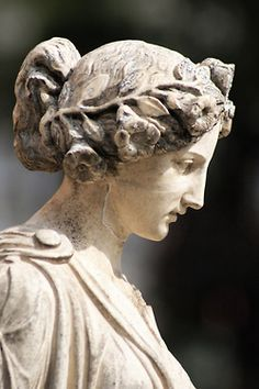 lovely statue with floral headdress
