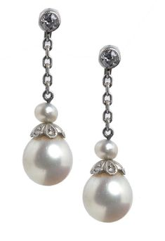 A PAIR OF PEARL AND DIAMOND EARRINGS, EARLY 20TH C  the larger pearl suspended from a chain, in white gold, 23mm, 2.2g  Sold @ Mellors & Kirk