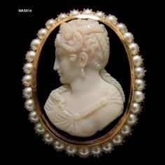 Antique Carved Hard Stone Banded Agate Cameo Brooch Depicting A Woman In Profile With Braided Hair,  Mounted In A 14k Gold Frame Surrounded By Lustrous Half Pearls   c. Early 19th Century