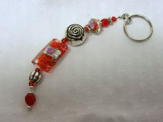 Red glass and floral beads with large silver bead by annabellasbling, $10.00