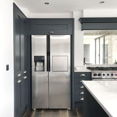 Charcoal kitchen inspiration shaker style silestone lagoon worktop stainless steel american fridge freezer rangemaster falcon range cooker and faux chimney breast dark wood floors dulux rock salt wall paint antique mirror splashback Shaker Style Kitchens, Kitchen Cabinet Styles, New Kitchen, Shaker Style Kitchen Cabinets, Range Cooker, American Style Fridge Freezer, Kitchen Styling, Wood Worktop, Charcoal Kitchen