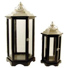 "Set of two candle lanterns with black wood frames and silver ventilators.  Product: Small and large lanternConstruction Material: Wood, glass, and metalColor: Black and silver  Accommodates: (1) Candle each - not included  Dimensions: 26"" H x 13"" Diameter  (large)"