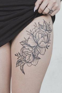 Peony flower thigh tattoo. More