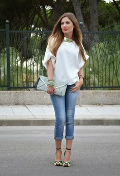 White stylish blouse with sky blue casual plan jeans and grey leather hand bag and stylish cute pumps