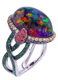 Katherine Jetter Femme Fatale Ring II 7.95ct Mexican Anhydrous Opal, Black Diamonds, Tsavorite Garnet, and Rubies are arranged in perfect synchronicity to form this magnificent Collector's ring.