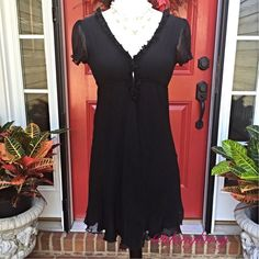 "Free People Silk Dress  HP1/2/15 Erikagannon Floaty and light, this black dress has a ruffle at neckline and a stretchy bodice that closes in front with hook and eye hooks. 100% silk! 31 inches long with bust size 26"". Host Pick by rosemary atl  for the Girly Girl Party on 5.4.15 Free People Dresses"
