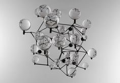 Fixed Orbit, 2008, solid glass, steel, hardware, 26 x 24 x 28 inches graham caldwell