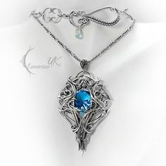 Exclusive jewelry - necklace. Fully hand made work (wire wrapping technique with oxydizing and polished silver). Main base gems: Blue Quartz 5,6 Ct (1,2g). Additional stones: London Blue Topaz 2,0 Ct (0,4g). Material: Sterling Silver, Fine Silver / 925, 999. Chain lenght: 48 cm + 7 cm + 9 cm (Plain Oval Belcher) with a decorative clasp, adjustable. Pendant: length 5,9 cm, width 3,8 cm. Necklace weight: 22,8g. Color: Silver, Blue.