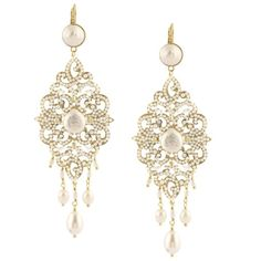 This pair of earrings are exquisitely luxurious and glamorous. Capturing a touch of the  baroque spirit, these feminine earrings are bright with freshwater pearls and decorated with little pearly beads and brilliant Swarovski crystals. Unforgettable.