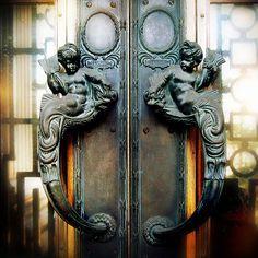 Front entrance art nouveau door handles of Trinity Square with mer children ~ hauntedmansion