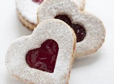 These scrumptious Valentine's Day cookies feature just the right amount of the refreshing, all-natural sweetness thanks to some great preserves! Make them with Cherry or Raspberry preserves – the bold red colors are festive enough for Valentine's Day and delicious enough for anytime! Celebrate the season by serving them to guests or packing a batch to pass out at work or school! Hungarian Cookies, Hungarian Desserts, Hungarian Cuisine, Hungarian Recipes, Hungarian Food, Cake Cookies, Linzer Cookies, Cupcakes, Slovakian Food