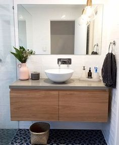 """Emily and Mitch absolutely love how their vanity tuned out, and so do we! The light, clear feature of the solid Australian chestnut works perfectly with all the elements of the bathroom including the """"Urban"""" caesarstone top. Bathroom Inspo, Bathroom Layout, Open Shelving, Shelves, Timber Vanity, Birch Ply, Floating Vanity, Kitchen Benches, Shelving"""