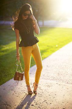 Black peplum top with yellow skinny jeans