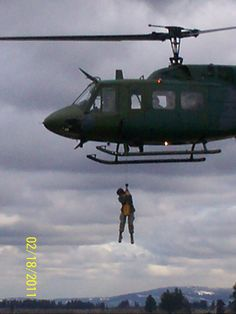 USAF US Air Force SERE Survival School Forest Penetrator UH-1 Huey Helicopter Rescue Training