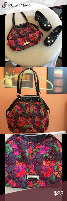 Betsey Johnson Tote Bag Multi colored with skulls, roses, and polka dots. Measures 16in wide x 11.5in long. Has inside zipper pocket and two inside open pockets. Used a few times, still in excellent condition and clean. Shoes in pic are also for sale and listed in my closet. Make offers! Bundle and save! Betsey Johnson Bags Totes